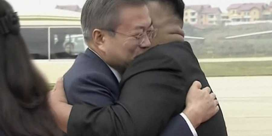 Moon and Kim begin summit after limo ride through Pyongyang