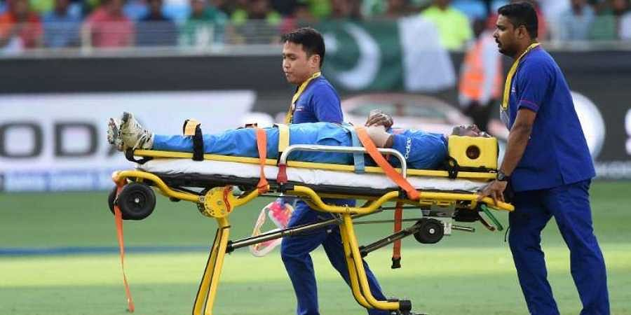 Indian cricketer Hardik Pandya is carried on a stretcher after getting injured during the one day international (ODI) Asia Cup cricket match between Pakistan and India at the Dubai International Cricket Stadium in Dubai. (Photo | AFP)