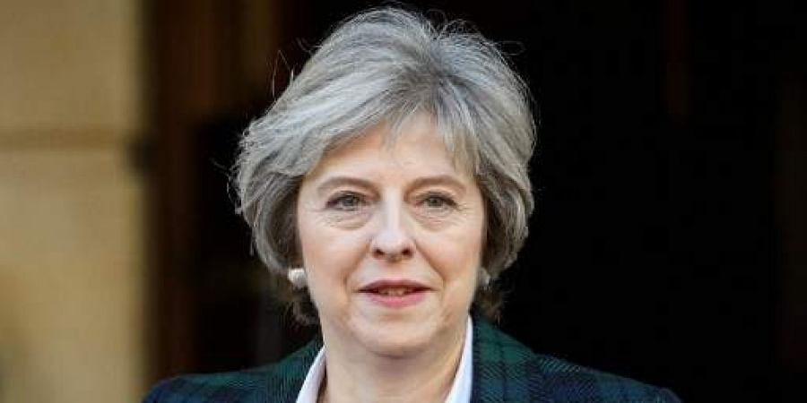 UK PM May: Will not surrender to Brussels