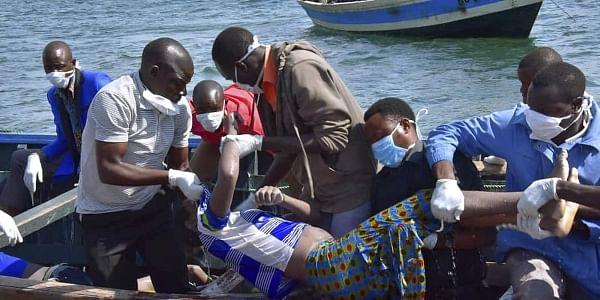 Rescuers retrieve a body from the water near Ukara Island in Lake Victoria, Tanzania | AP