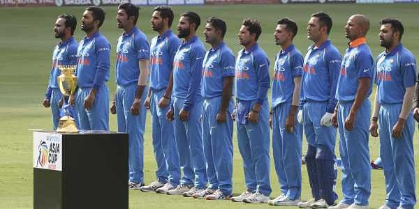 Members of Indian team stand for their national anthem before the start of the one day international cricket match of Asia Cup between India and Bangladesh in Dubai. (Photo   AP)