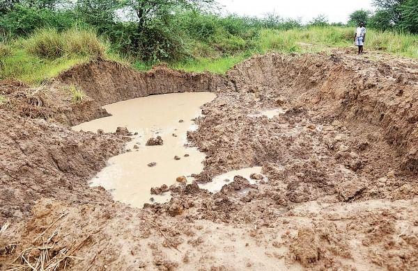 Sand dug out of the lake bed at Pandeshwaram village in Tiruvallur district |  D SAMPATHKUMAR