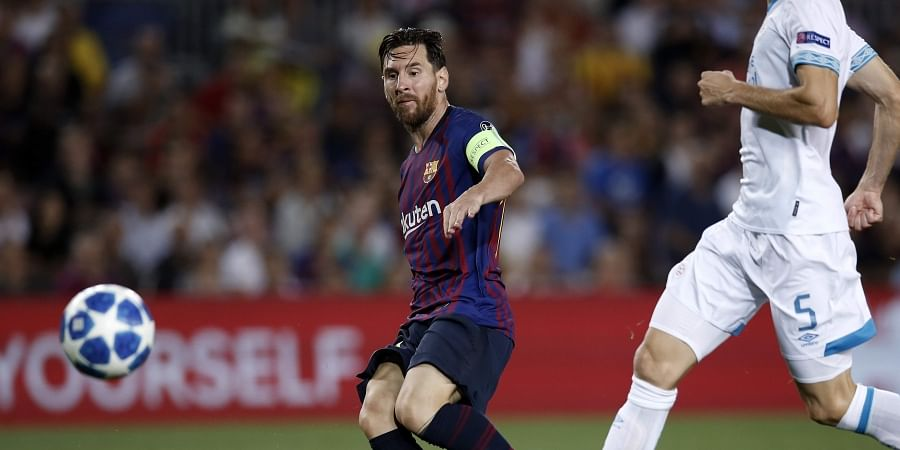 354f7ca4b Barcelona forward Lionel Messi scores his side s fourth goal during the  group B Champions League soccer match between FC Barcelona and PSV  Eindhoven at the ...