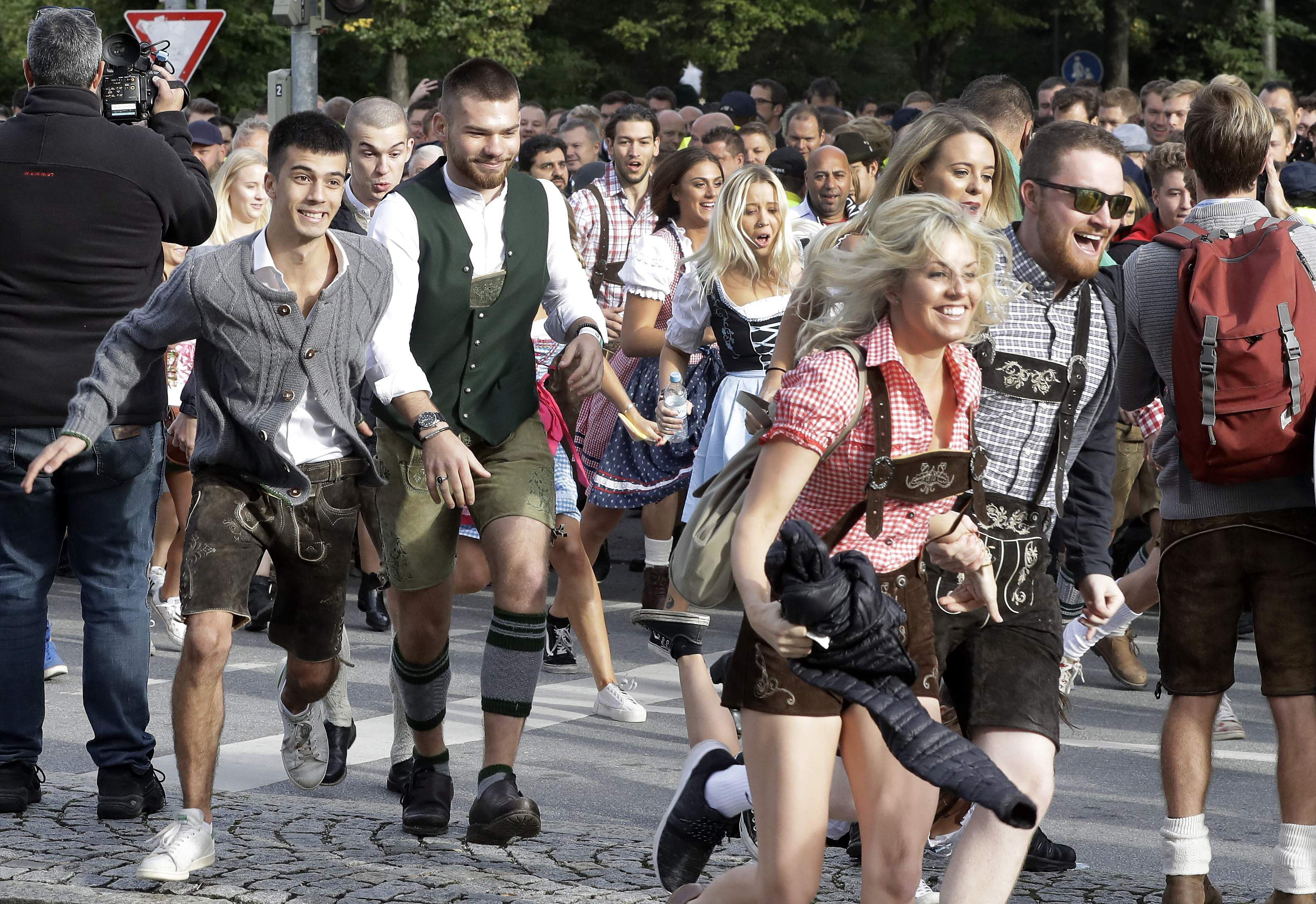 People run to enter the 185th 'Oktoberfest' beer festival in Munich, Germany.  (Photo | AP)