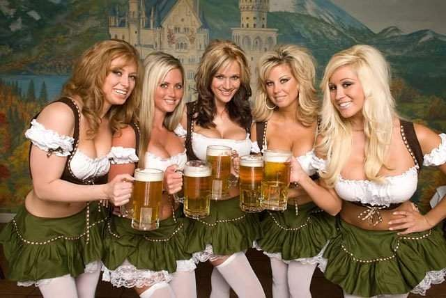 Girls in traditional Bavarian dress enjoy the beer. (Twitter)