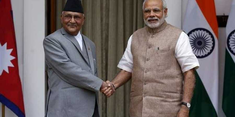 Prime Minister Narendra Modi with his Nepali counterpart Sharma Oli. (File Photo| Reuters)