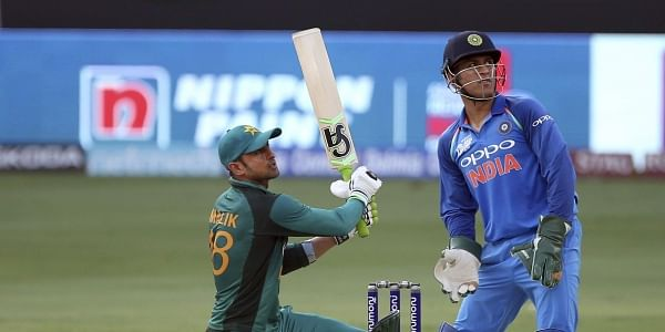 Pakistan's Shoaib Malik, left, watches the ball after hitting a six during the one day international cricket match of Asia Cup between India and Pakistan in Dubai. (AP)