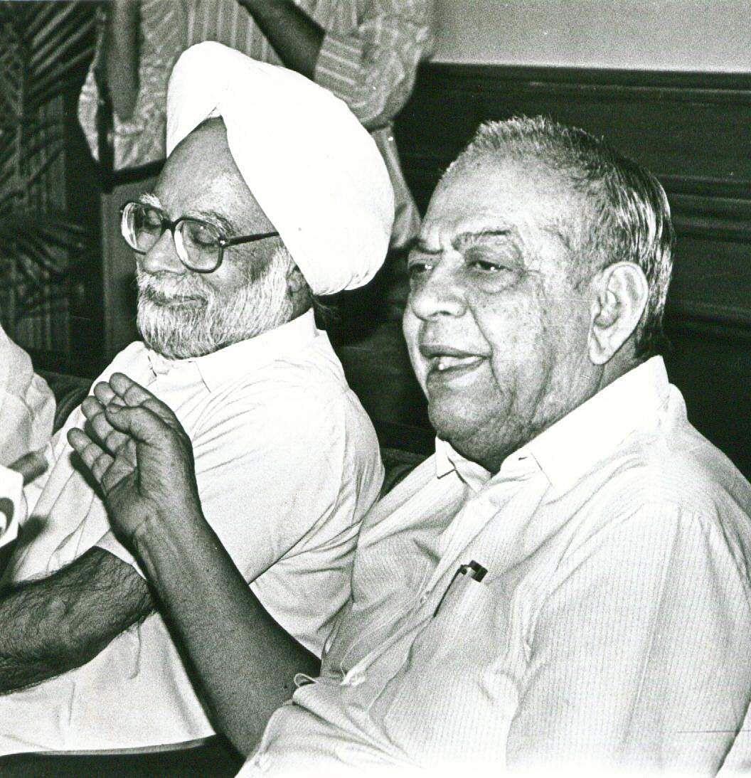 Manmohan Singh with Union minister Indrajit Gupta. (Photo | File/EPS)