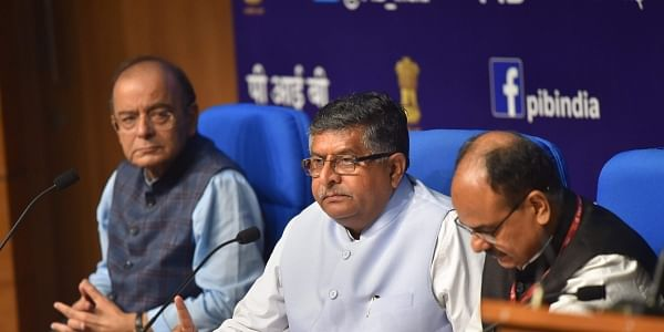 L to R Union Finance Minister Arun Jaitley, Law Minister Ravi Shanker Prasad and Chief Executive Officer (CEO) of Unique Identification Authority of India UIDAI Ajay Bhushan Pandey during a press conference on Cabinet decisions in New Delhi Wednesday September 26 2018. | PTI