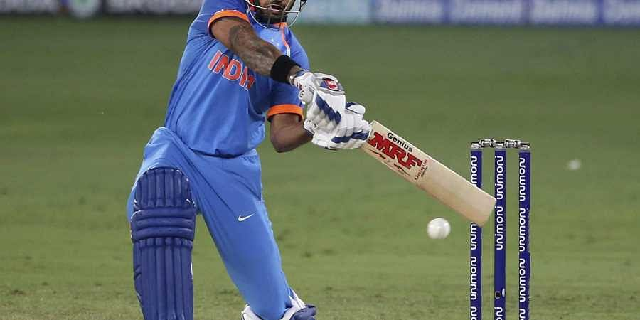 India's Shikhar Dhawan plays a shot against Bangladesh during the Asia Cup Super-Four match. (File | AP)