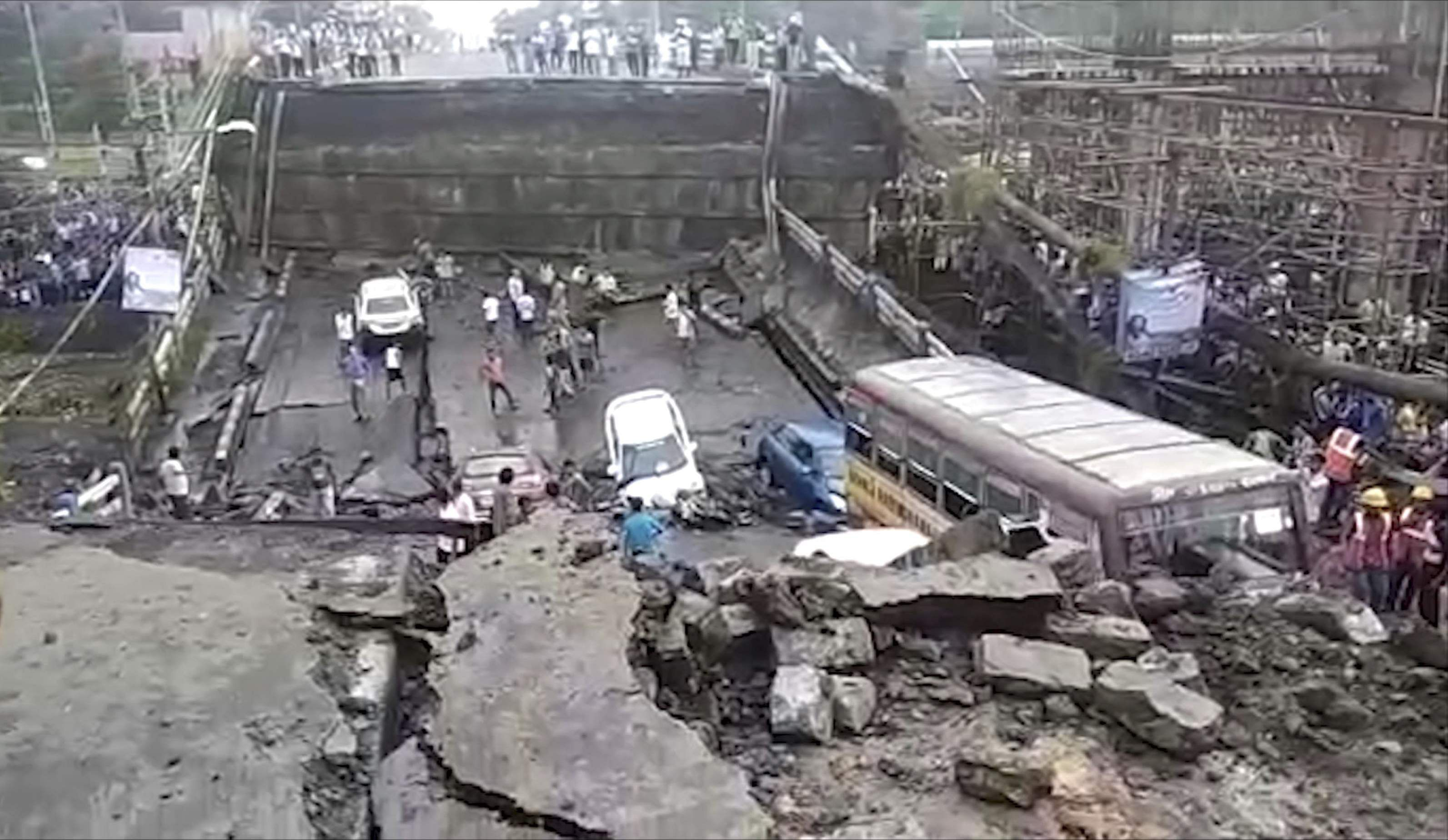 Rescue workers remove vehicles and debris from the collapsed Majerhat bridge in Kolkata Tuesday Sep 04 2018.
