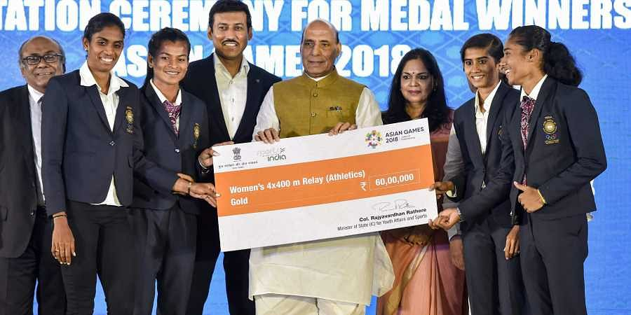 Union Home Minister Rajnath Singh felicitates Asian Games Gold Medalists in Women relay team during the Asian Games felicitation ceremony in New Delhi. (Photo | PTI)