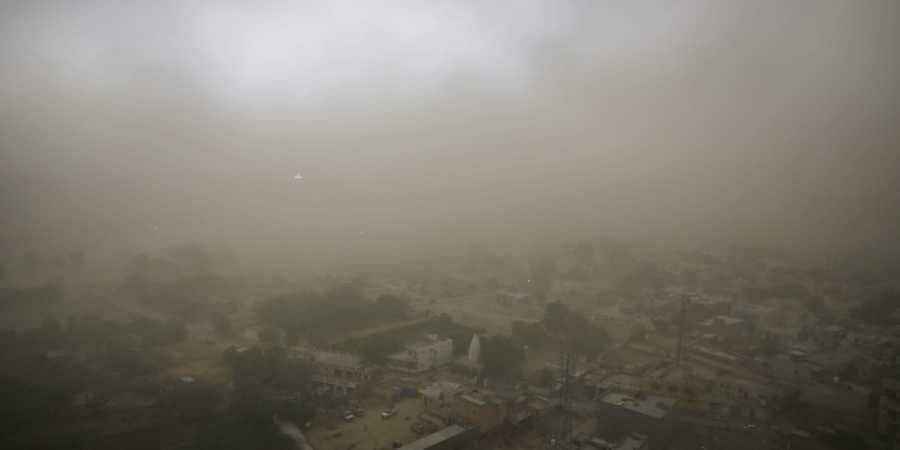 Dust storm with a wind speed of up to 109 kmph barrelled through Delhi and neighbouring areas as well. (AP)