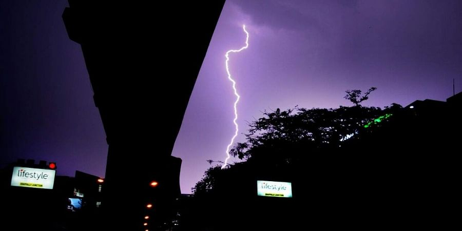 Kochi witnessed lightening accompanied by heavy showers on Friday evening. The heavy down pour along with wind also resulted in waterlogging and uprooting of trees in different part of the city. A view of lightening from benethe the metro rai track.Photo