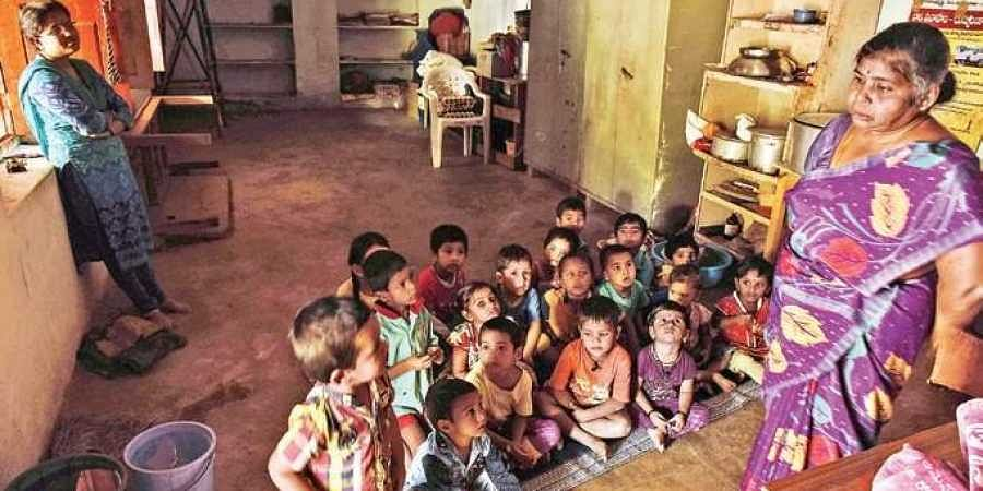 More than 30 children enrolled with the anganwadi centre in Ameerpet sit on the floor of a dimly lit room with no ventilation or power supply | Vinay Madapu