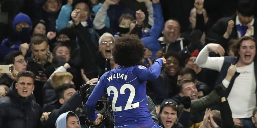 Chelsea's Willian celebrates his side's second goal during the English Premier League soccer match between Chelsea and Newcastle United at Stamford Bridge stadium in London. (Photo | AP)