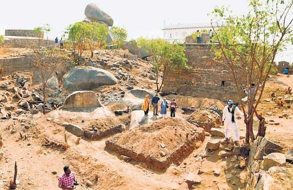 Heritage activists inspecting the pit where the construction of a toilet has been proposed at Golconda Fort | Express