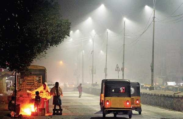 Smog envelopes Flower Bazaar in the early hours of Monday as people celebrated Bhogi by burning waste | DEBADATTA MALLICK