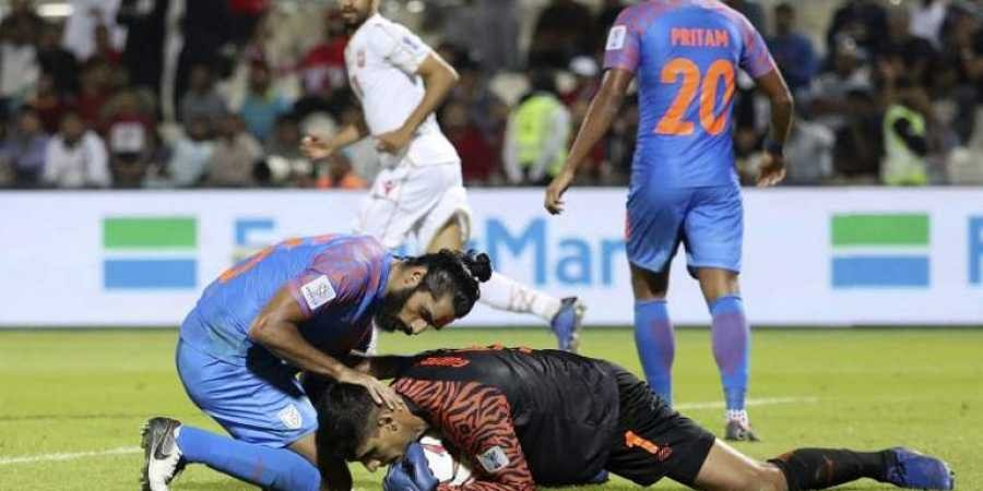d409b9711ea India's defender Sandesh Jhingan (L) protects India's goalkeeper Gurpreet  Singh Sandhu during the 2019 AFC Asian Cup group A football match between  India ...