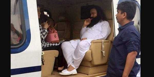 Dera Sacha Sauda chief Gurmeet Ram Rahim in a helicopter in which he was flown from Panchkula to Rohtak town to be lodged in jail. (Photo | File/ PTI)