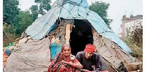 The elderly couple in front of their hut in Narendrapur | Express
