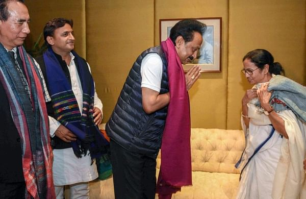 West Bengal Chief Minister Mamata Banerjee exchange greetings with DMK President M.K.Stalin while SP chief Akhilesh Yadav looks on at a city hotel in Kolkata Friday Jan 18 2019. | PTI