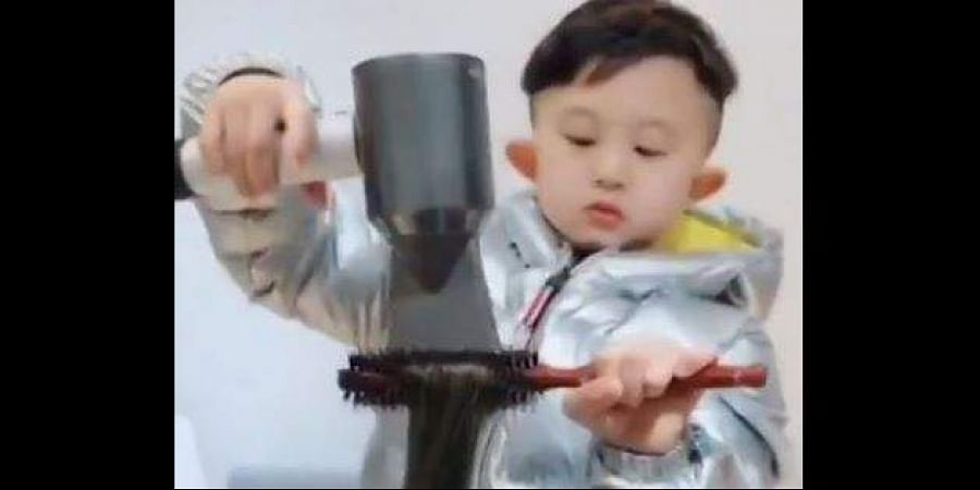 Jiang Hongqi, a six-year-old Chinese kid, is breaking the internet for his hairdressing skills. (Photo | screengrab)
