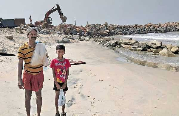 Sashi N and his son Devanarayanan return from fishing at Vellanathuruth where IRE is carrying out sand mining