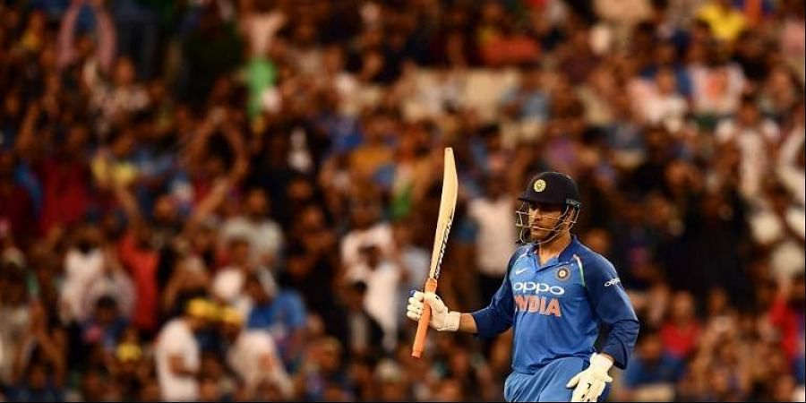India S Mahendra Singh Dhoni Rises His Bat After Scoring A Half Century 50 Runs During The Third One Day International Cricket Match Between Australia And