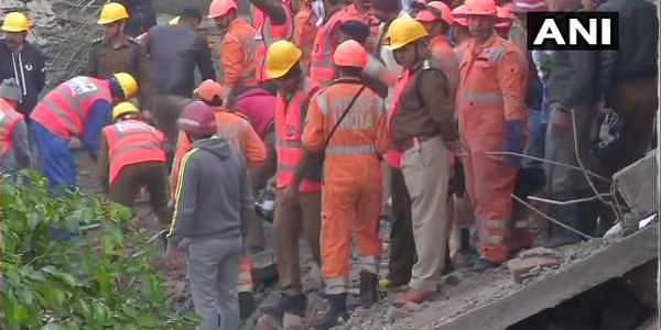 NDRF teams arrive at the site of building collapse in Ullawas, Gurugram. (Photo: ANI)