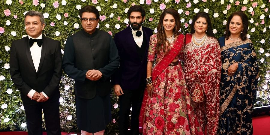 Family Members along with newly wed Amit Thackeray and Mitali Borude pose for a picture during their reception in Mumbai. (Photo   PTI)