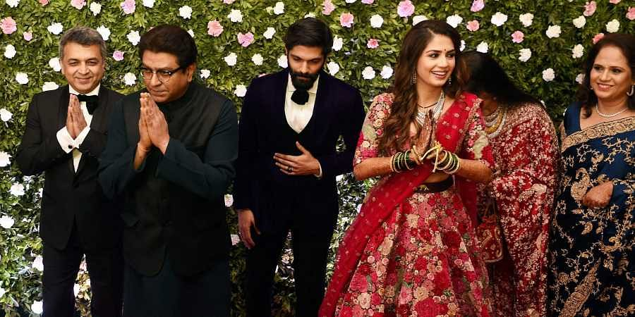 Family Members along with newly wed Amit Thackeray and Mitali Borude pose for a picture during their reception in Mumbai. (Photo | PTI)
