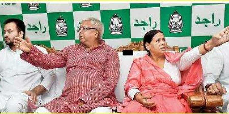 RJD Chief Lalu Prasad Yadav with wife Rabri Devi and Tejaswi Yadav (L) in Patna. (Photo| File\ PTI)