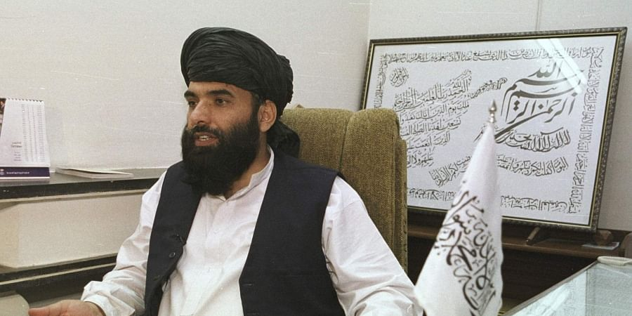 FILE - In this Nov. 14, 2001 file photo, Suhail Shaheen, then Deputy ambassador of the Islamic Republic of Afghanistan, gives an interview in Islamabad, Pakistan. (Photo   AP)