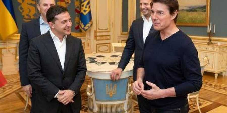 This handout picture taken and released by the Ukrainian Presidential press-service shows President Volodymyr Zelensky (L) talking with US actor and film producer Tom Cruise (R) during their meeting in Kiev late on September 30, 2019.