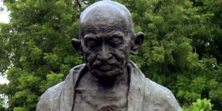 A statue of Mahatma Gandhi is shown in the Indian parliament
