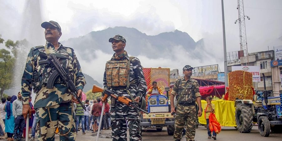 CRPF soldiers stand guard during a procession on the the first day of Navratri festival at Katra about 45 kms from Jammu Sunday Sept. 29 2019. | (Photo | PTI)