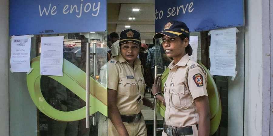 Mumbai Police personnel stand guard outside Punjab and Maharashtra Cooperative Bank PMC at GTB Nagar in Mumbai