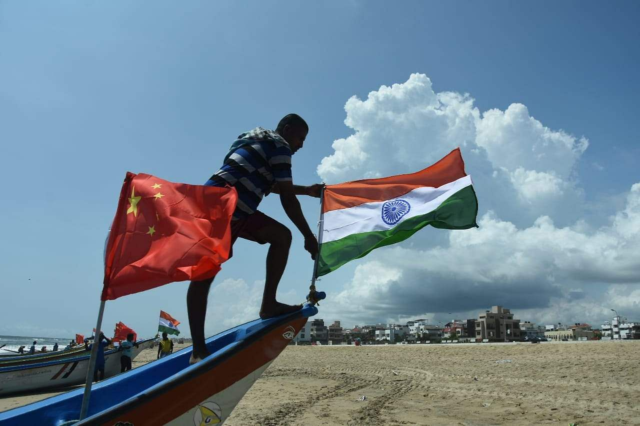 Fishermen at Palavakkam Beach tie national flags of China and India on their boats to welcome the Chinese premier Xi Jinping. (Photo | Ashwin Prasath, EPS)