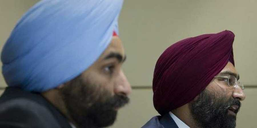 Chairman of Fortis Healthcare Malivnder Singh (R) answers a question as his brother and Managing Director Shivinder Singh sits next to him during a news conference in Singapore. (File Photo | REUTERS)