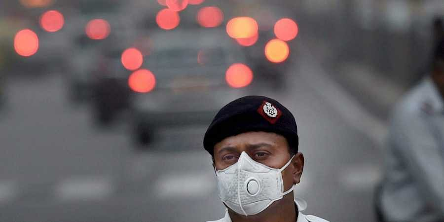 A traffic policeman wears an anti-pollution mask to protect himself from growing level of air pollution in New Delhi.