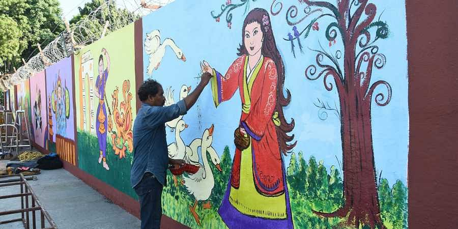 Preparations are in full swing to welcome Chinese President Xi Jinping at Chennai Airport. Paintings depicting Chinese and Indian history been depicted in the airport walls in welcoming the president.   (Ashwin Prasath   EPS)