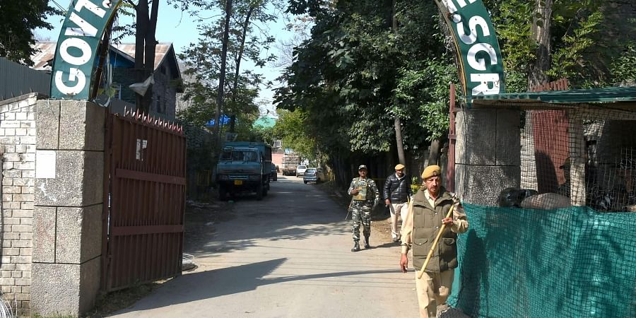 Security personnel stand guard outside the main gate of a college in Srinagar Wednesday Oct. 9 2019. | (File | PTI)