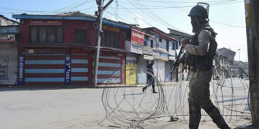 A security personnel stands guard during restrictions in Srinagar Wednesday Oct. 9 2019.   (File   PTI)