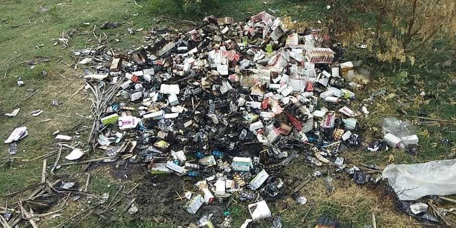Medical wastes being dumped in the  Tiruneermalai lake.