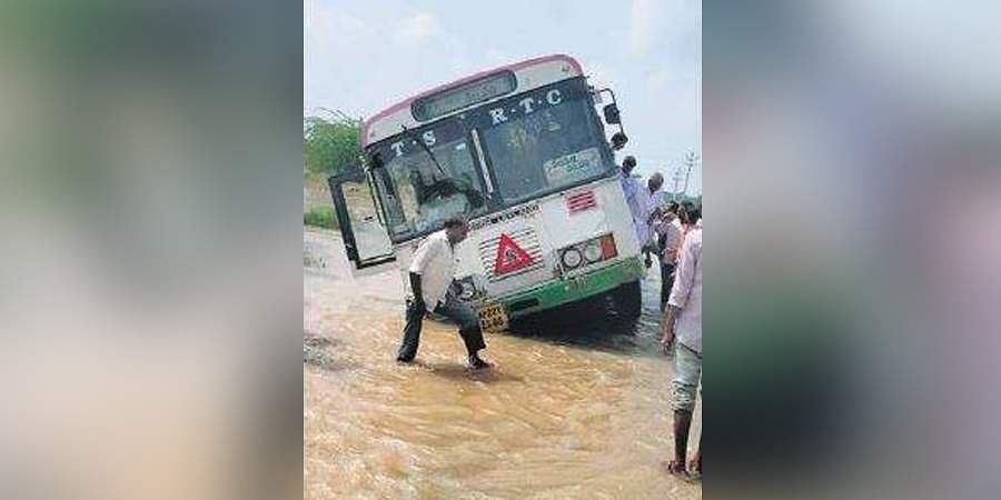The RTC bus seen partially stuck in the Dundubhi river canal