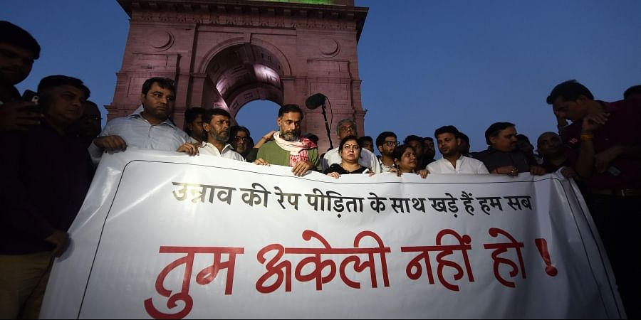 People assemble to send across a message of solidarity to the Unnao rape Victim at India Gate in New Delhi.