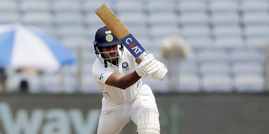 India's Mayank Agarwal bats during the second cricket test match between India and South Africa in Pune.