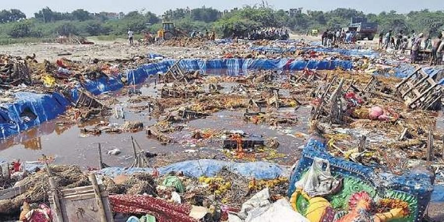 Debris in an immersion pond a day after the Durga Puja festival.
