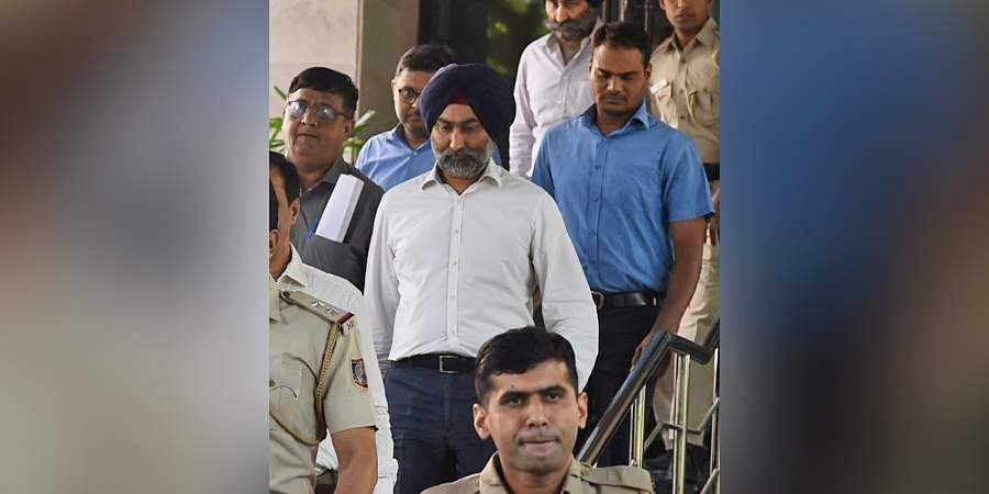 Promoter of Religare Enterprises and the Fortis Healthcare hospital chain Shivinder Mohan Singh, being taken to Court by Economic Offences Wing of the Delhi Police officers from EOW office , Mandir Marg in New Delhi on Friday.